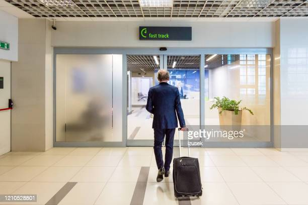 businessman going to vip lounge at the airport - celebrities stock pictures, royalty-free photos & images