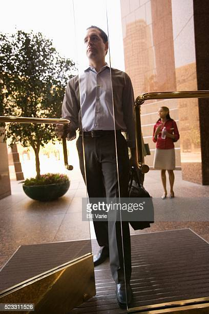 businessman going to work - human doormat foto e immagini stock