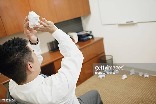 businessman goofing off at work - encestar fotografías e imágenes de stock