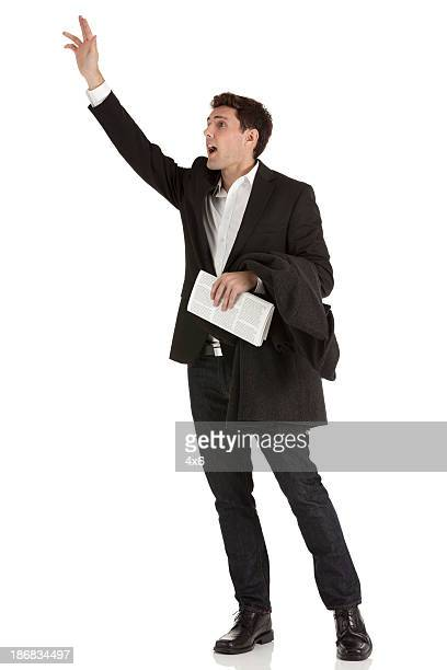 businessman hailing a cab - overcoat stock pictures, royalty-free photos & images