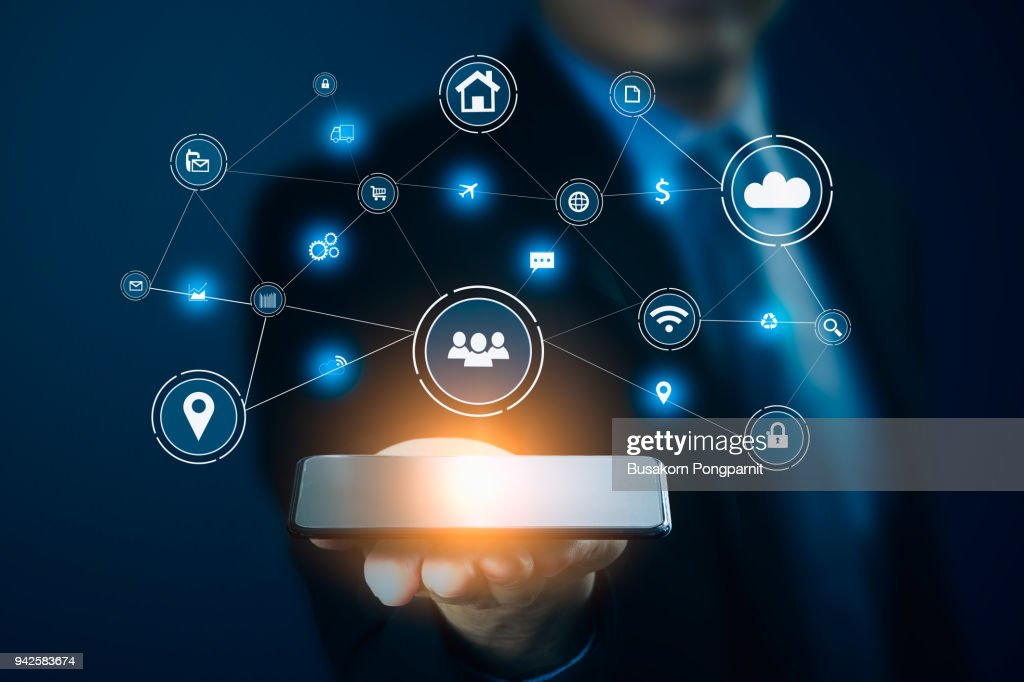Businessman hand holding smart phone.Virtual digital technology concept,Social media : Stock Photo