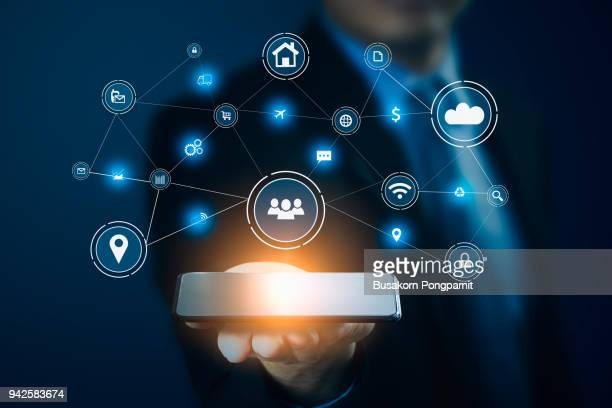 Businessman hand holding smart phone.Virtual digital technology concept,Social media