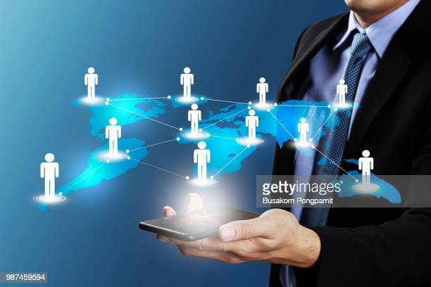 businessman hand holding smartphone with icons with technology, internet and communication, social network  concept - multimedia stock pictures, royalty-free photos & images