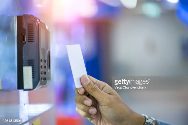 Businessman hand inserting key card to door access control keypad with key card reader, security policy
