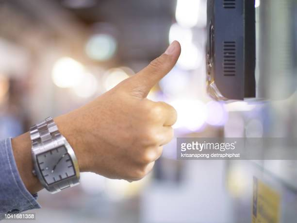 businessman hand scanning finger on machine,technology concept, business concept, - biometrics stock pictures, royalty-free photos & images