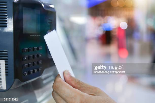 Businessman hand scanning finger on machine,Technology concept, Business concept,