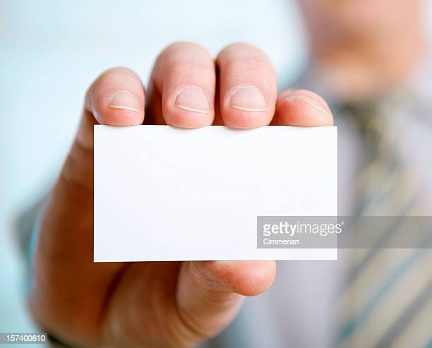 Businessman hand showing a blank card