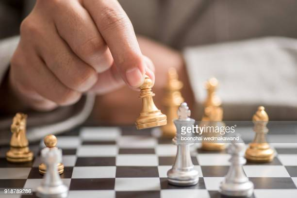businessman hand with businessman goal with chess - chess stock pictures, royalty-free photos & images