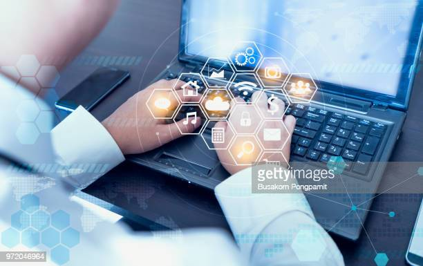 businessman hand working with laptop computer  with technology digital graphic - marketing icons stock photos and pictures