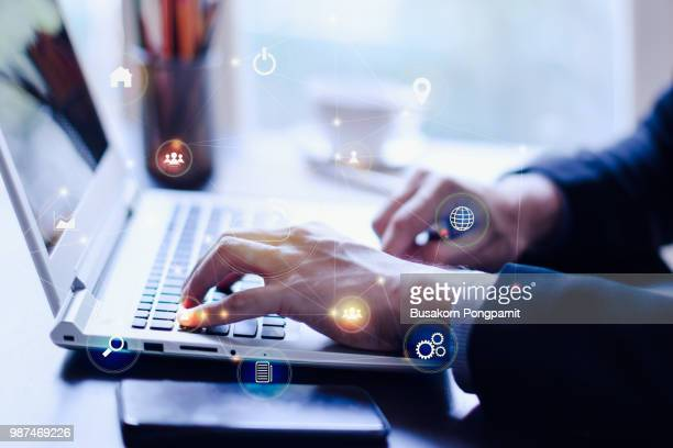 businessman hand working with mobile phone and laptop computer  with technology digital graphic - digital enhancement stock pictures, royalty-free photos & images