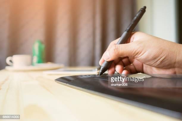 Businessman handing tablet pen and start up writing message
