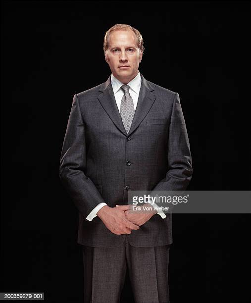 businessman, hands clasped, portrait - gray suit stock pictures, royalty-free photos & images
