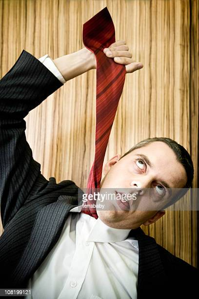 Businessman Hanging Himself with Neck Tie