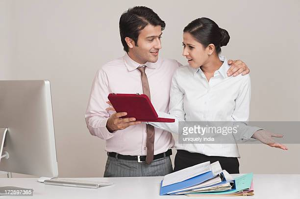 Businessman harassing a businesswoman in an office