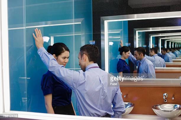 Businessman Harassing Businesswoman in Restroom