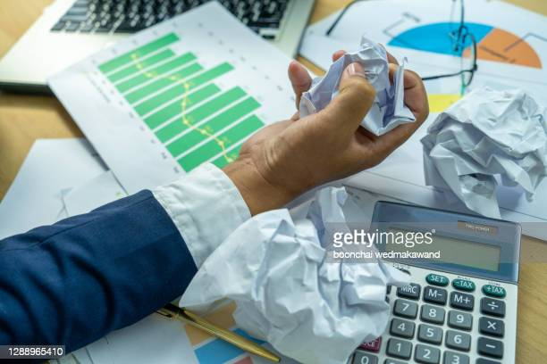 businessman hard working in the documents - aggression stock pictures, royalty-free photos & images