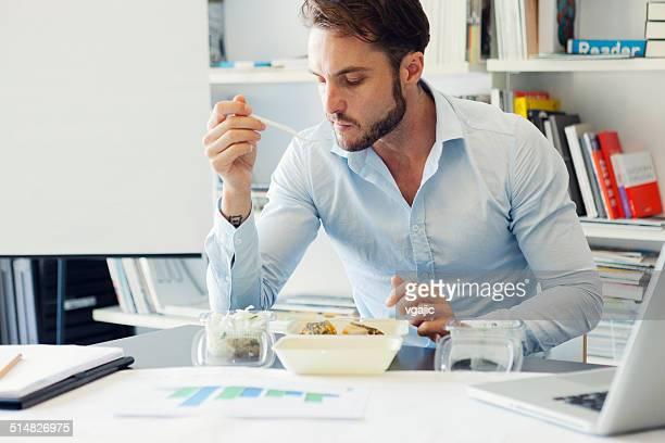 Businessman have lunch break in office.