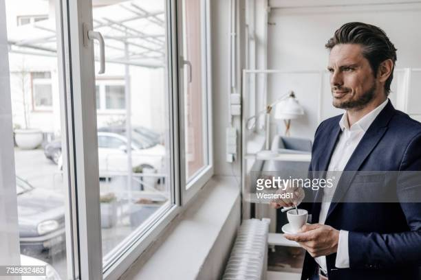 Businessman having a coffee at the window