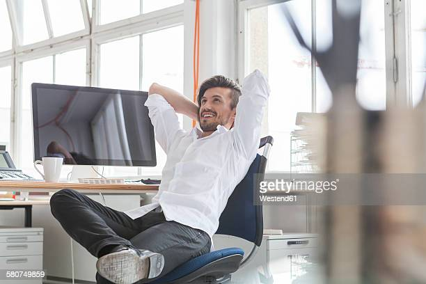 Businessman having a rest in his office
