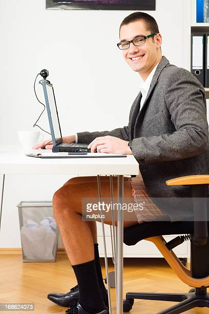 businessman having a teleconference in shorts
