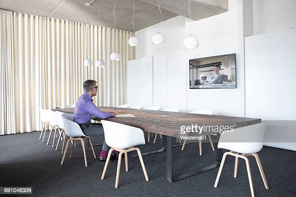 Businessman having a video conference in board room