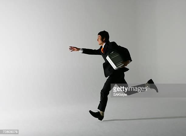 Businessman having bag ,running