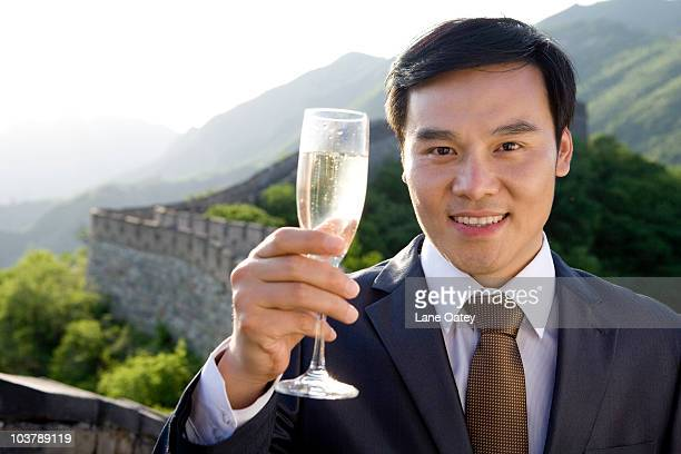 Businessman having champagne on the Great Wall