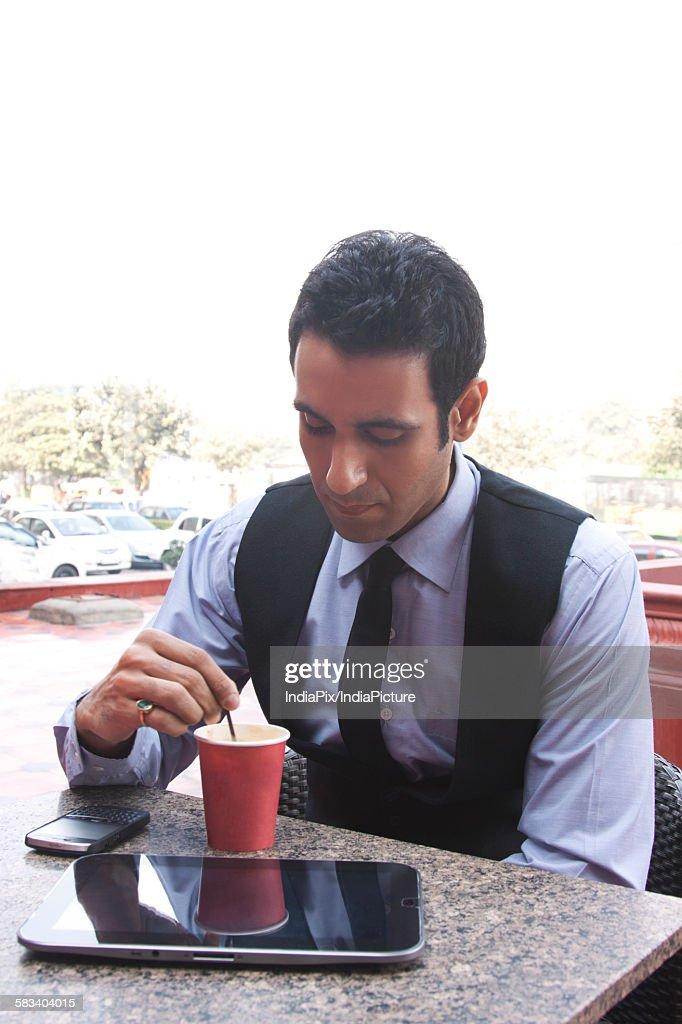 Businessman having coffee , INDIA , DELHI : Stock Photo