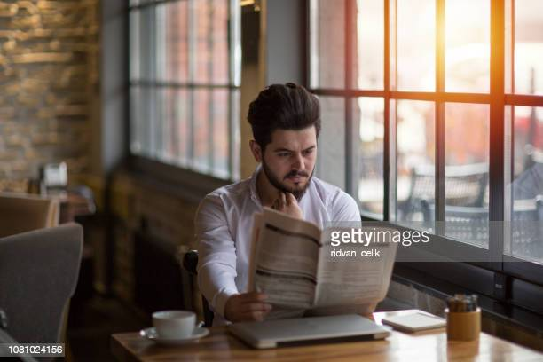 businessman having coffee with newspaper - newspaper stock pictures, royalty-free photos & images
