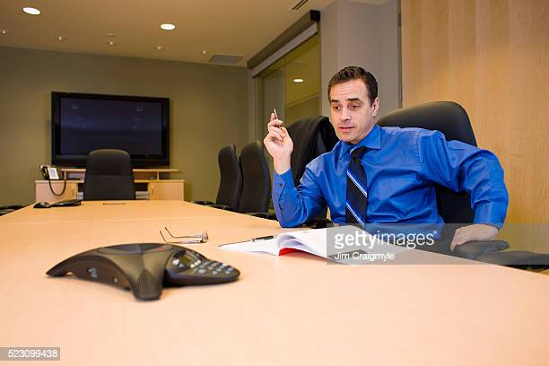 businessman having conference call - jim craigmyle stock pictures, royalty-free photos & images