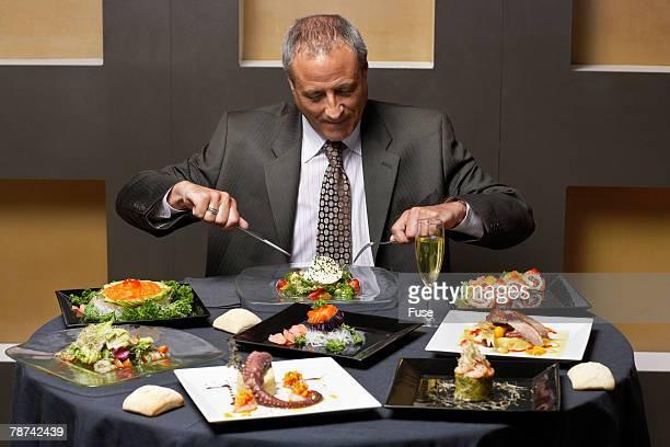 Businessman Having Dinner
