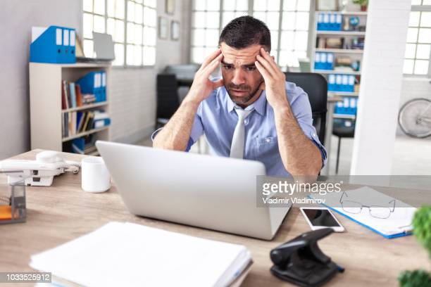 businessman having headache at work - stock trader upset stock pictures, royalty-free photos & images