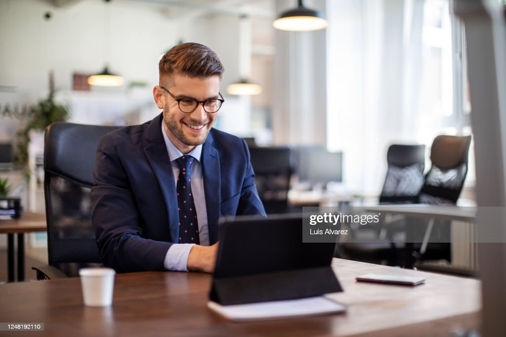 Businessman having online briefing with team at office : Stock Photo