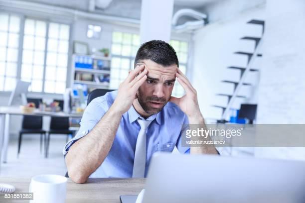 Businessman having problems at work
