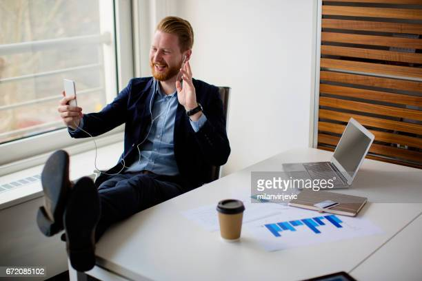Businessman having video call via mobile phone