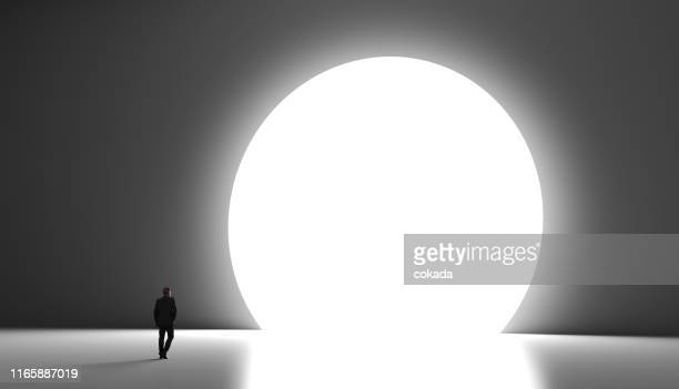 businessman heading to new opportunities - light at the end of the tunnel stock pictures, royalty-free photos & images