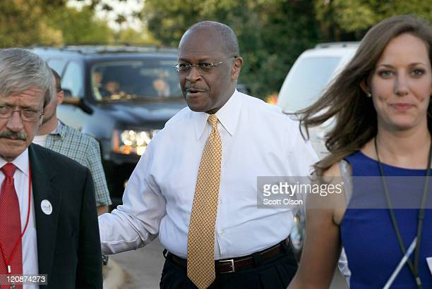 Businessman Herman Cain arrives at the Stephens Auditorium at Iowa State University for the Republican party debate August 11 2011 in Ames Iowa Most...