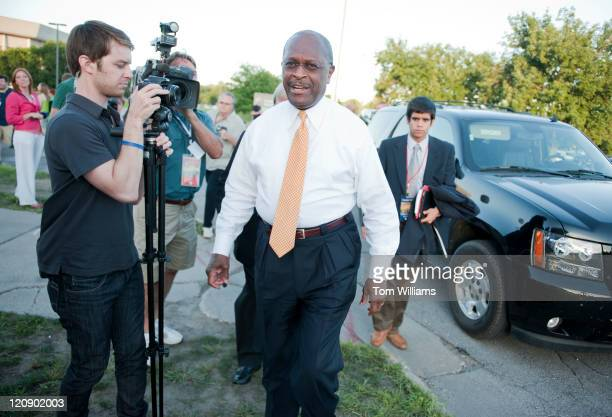 Businessman Herman Cain arrives to Stephens Auditorium at Iowa State University for the Republican presidential debate in Ames Iowa The debate will...