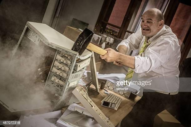 Businessman hitting hammer on CPU