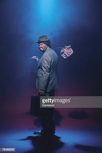 businessman hobo character in clown makeup - sad clown stock photos and pictures