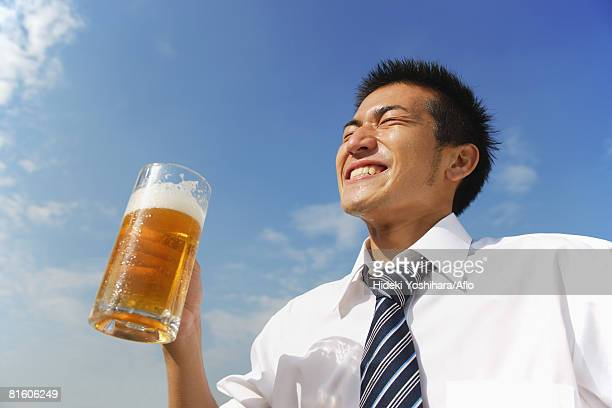 Businessman Holding a Beer