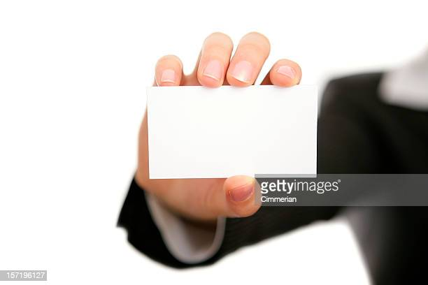 A businessman holding a blank business card