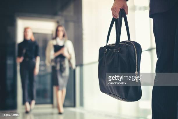 Businessman holding a briefcase closeup shot