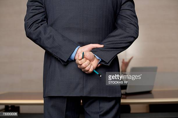 Businessman holding a broken pencil in his hand