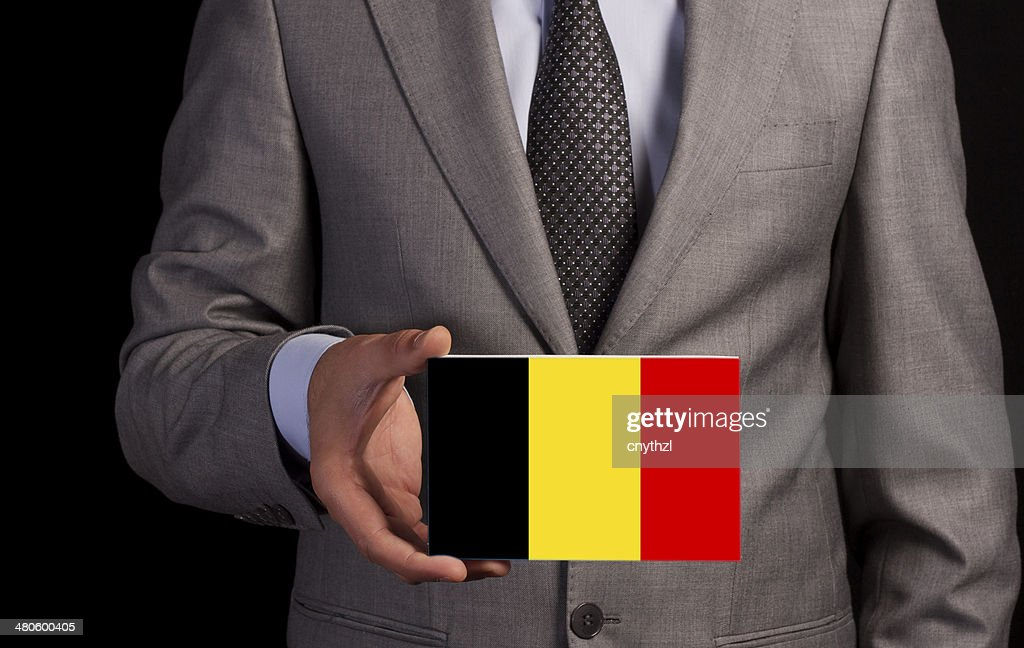 Businessman Holding a Card with BELGIUM Flag : Stock Photo