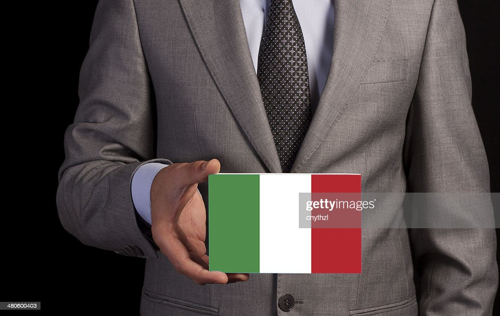 Businessman Holding a Card with ITALY Flag : Stock Photo