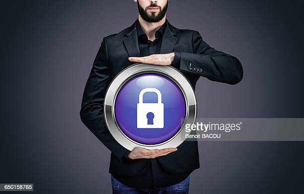 Businessman holding a circle containing the symbol padlock