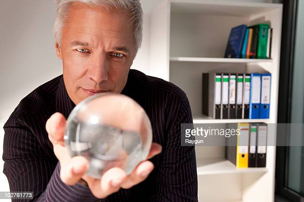 Businessman holding a crystal ball