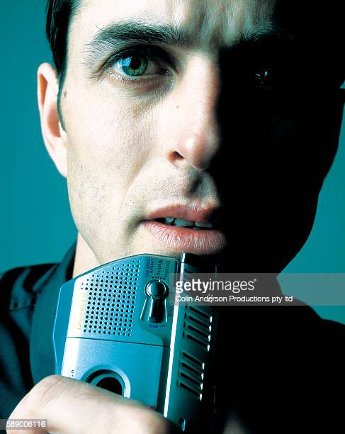 Businessman Holding a Dictaphone