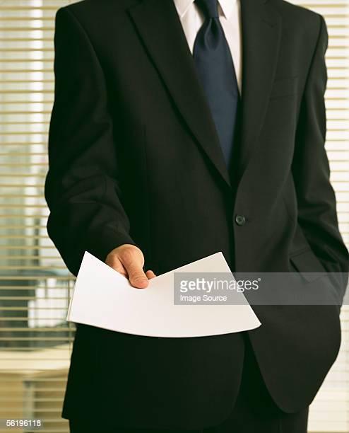 businessman holding a document - 手渡す ストックフォトと画像